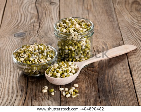 Healthy eating. Sprouted lentils in a wooden spoon and glass - stock photo