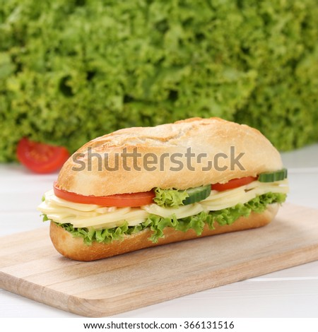 Healthy eating sub deli sandwich baguette with cheese, tomatoes and lettuce