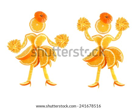 Healthy eating. Two funny little women made of the orange slices. - stock photo