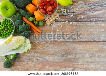 healthy eating, vegetarian food, advertisement and culinary concept - close up of ripe vegetables on wooden table - stock photo