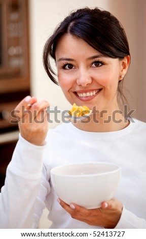 Healthy eating woman having cereals for breaksfast