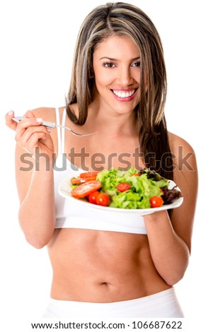 Healthy eating woman holding a salad and smiling - isolated over white