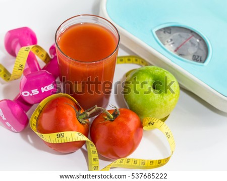 Healthy eating ,Workout and fitness dieting ,fitness and weight loss concept, fruit, Vegetable and tomato juice,weight scale,on white background