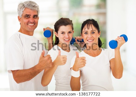 healthy family giving thumbs up after exercising - stock photo