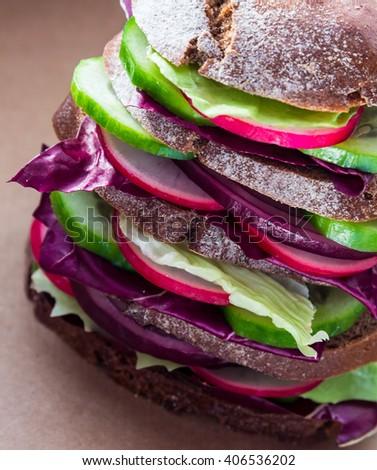 Healthy fast food vegan rye sandwich with fresh vegetables - stock photo