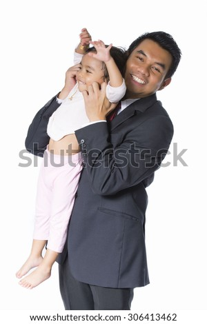 Healthy father and daughter playing together - stock photo