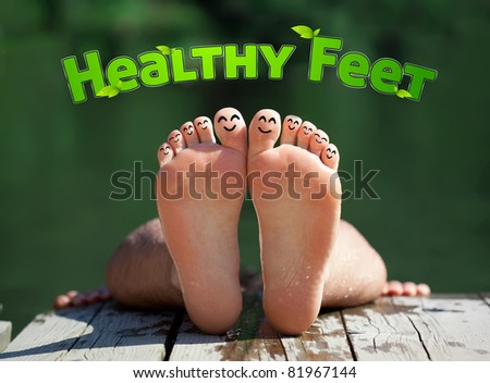 Healthy feet with happy finger smileys - stock photo
