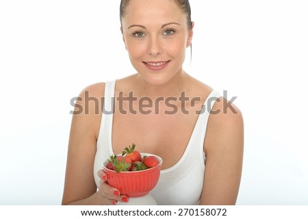 Healthy Fit Attractive Young Woman Holding a Bowl of Fresh Ripe Juicy Strawberries - stock photo
