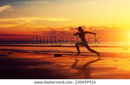 Healthy fitness woman running at sunset - stock photo