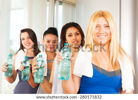 Healthy fitness women with water bottles - stock photo