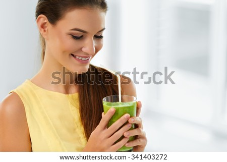 Healthy Food And Eating. Happy Young Woman Drinking Green Detox Vegetable Smoothie. Healthy Lifestyle, Vegetarian Diet And Meal. Drink Juice. Health Care And Beauty Concept. - stock photo