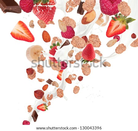 Healthy food and milk with flying cereals and fruit, isolated on white background - stock photo