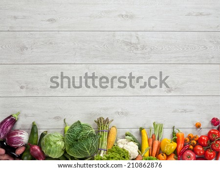Healthy food background / studio photography of different fruits and vegetables on wooden table  - stock photo