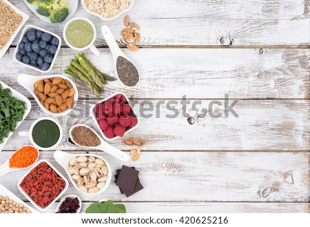 Healthy food called super foods on white, wooden background with copy space, top view - stock photo