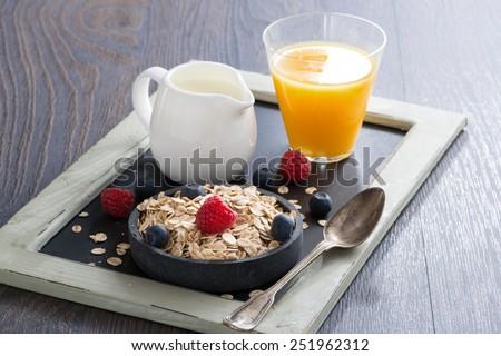 healthy food - cereal, fresh berries, milk and orange juice, horizontal - stock photo