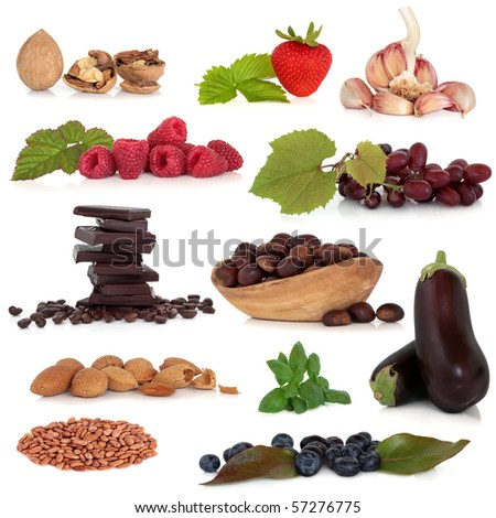 Healthy food collection very high in antioxidants and vitamins, isolated over white background. - stock photo