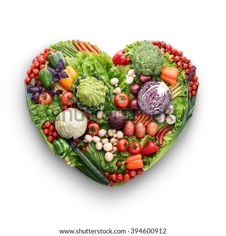 Healthy food concept of a human heart made of vegetable and fruit mix that reduce death risk, isolated on white. - stock photo