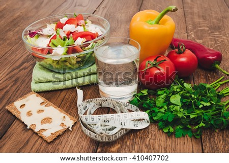 Healthy food for diet on a wooden table - stock photo