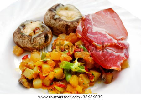 healthy food - fried potato, meat and mushrooms (champignones)