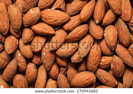 Healthy food, good for heart health.  Almonds as background.