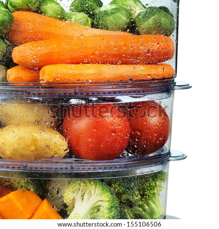Healthy food in steamer, steam cooker with various vegetables and fruits - stock photo
