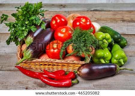 Healthy food ingredients. Fresh vegetables, herbs. Organic vegetables on wooden table. Healthy nutrition.