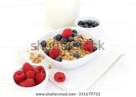 Healthy food. Muesli with berries in a bowl
