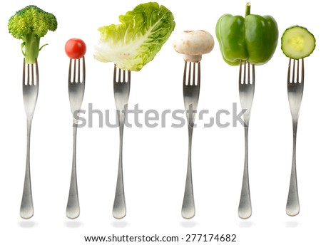 healthy food on a fork. Isolated on white.