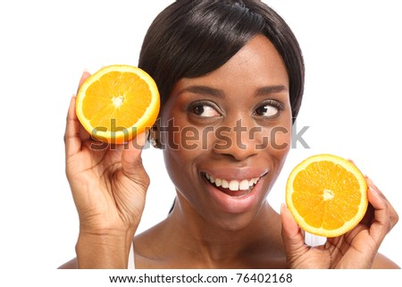 Healthy food promoted with happy smile with orange slice by beautiful young black woman. - stock photo