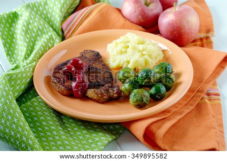 Healthy food. Steak under cranberry sauce garnished with Brussels sprouts and mashed potatoes. - stock photo