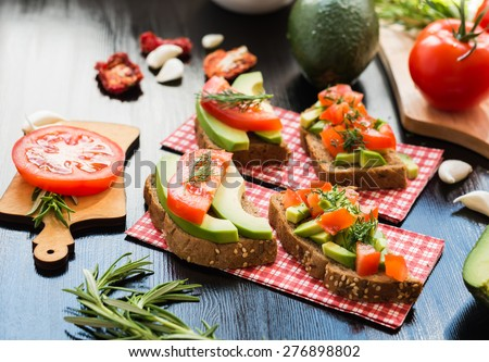 Healthy food. Vegan food. Vegetable appetizers. Sandwich : Rye Bread, Avocado, Tomatoes, Dill. - stock photo