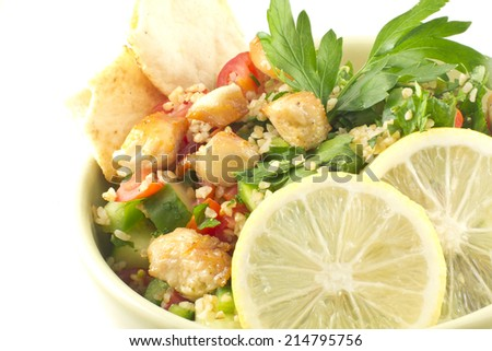 Healthy fresh chicken tabbouleh salad with pita chips - stock photo