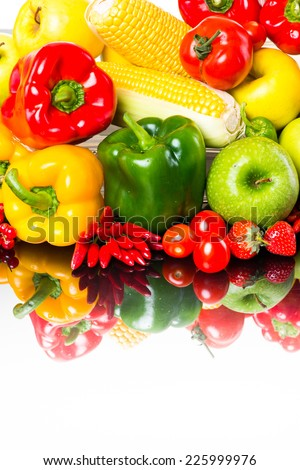 Healthy fresh colorful vegetables and fruits on white background.