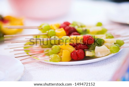 Healthy fresh fruits in a plate .Mixed fruits  on skewers isolated on white background - stock photo