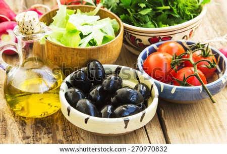 Healthy Fresh  Organic Vegetables, Olive, Radish, Tomatoes, Olive Oil with Parsley and Dill Greens, Italian Ingredients - stock photo