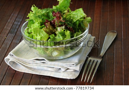 Healthy Fresh Salad on a wooden table - stock photo