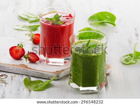 Healthy fresh Spinach and strawberry smoothies on a white wooden table. Selective focus