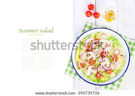 Healthy fresh summer salad with lettuce, radish, cherry tomatoes, red onion and field mushroom with italian herbs on a wooden background with olive oil, top view with copy space - stock photo