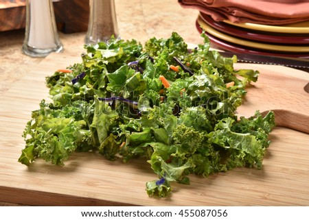 Healthy fresh washed kale mixed with carrot and cabbage slivers - stock photo