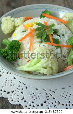 Healthy Fried rice with assorted vegetables, broccoli, capsicum, carrot, corn and long bean - stock photo