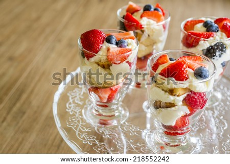 healthy fruit desserts with white chocolade mousse, shallow depth of field - stock photo