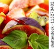Healthy fruit salad mix with strawberry syrup closeup photo - stock photo