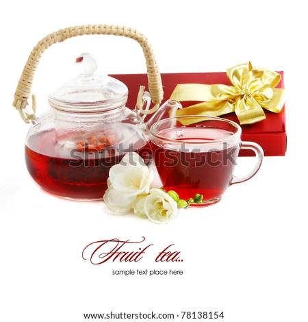 Healthy fruit Tea in a glass cup isolated in white. Shallow DOF. - stock photo