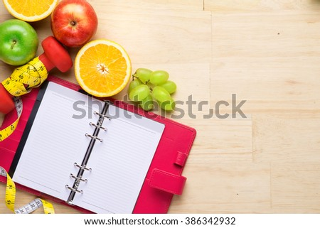 Healthy Fruit with measuring tape on wooden top , for lose weight ,Diet , still life background, Healthy lifestyle concep - stock photo