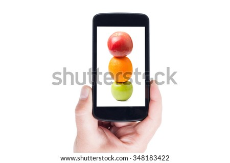 Healthy fruits as traffic lights picture on smartphone display or cellphone screen - stock photo