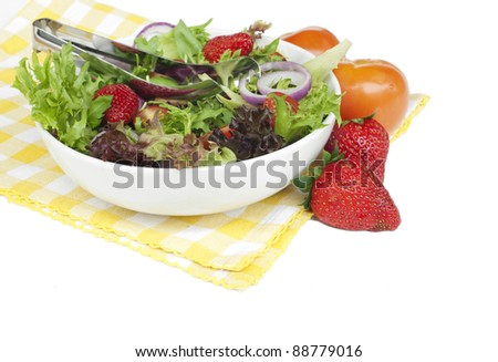 Healthy garden salad in stylish white bowl, isolated on white. - stock photo