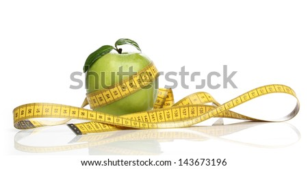 Healthy green apple and a measuring tape isolated - stock photo