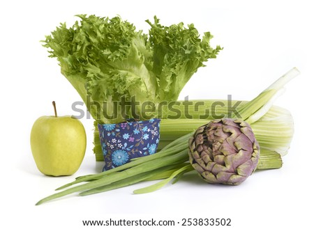 Healthy Green Food. Fresh lettuce leaves, celery stems, spring onion, artichoke and apple. - stock photo