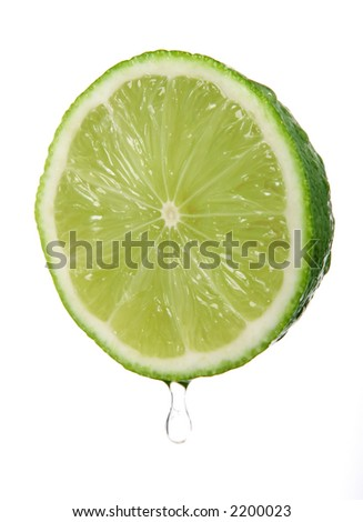 Healthy green lime fruit served with coctails isolated on white, macro closeup - stock photo