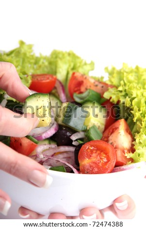 Healthy green salad isolated on white background - stock photo
